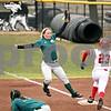 Rob Winner – rwinner@daily-chronicle.com<br /> <br /> Eastern Michigan's Nellie Coquillard is unable to make a play at first as Northern Illinois' Nicole Gremillion reaches on an error in the first inning on Friday, April 1, 2011, in DeKalb, Ill. NIU went on to defeat EMU in the first game of a doubleheader, 8-6.