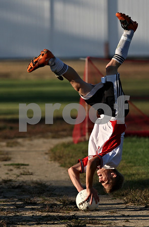 Rob Winner – rwinner@shawmedia.com<br /> <br /> Indian Creek's Caleb Gaston flip throws a ball onto the field during the second half in Waterman, Ill., on Monday, Sept. 19, 2011. Indian Creek defeated Hinckley-Big Rock, 2-1.