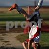 Rob Winner – rwinner@shawmedia.com<br /> <br /> Indian Creek's Caleb Gaston flip throws a ball onto the field during the second half in Waterman, Ill., on Monday, Sept. 19, 2011. Indian Creek defeated Hinckley-Big Rock, 2-1.