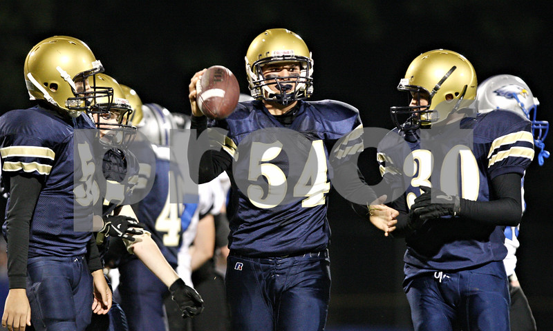Rob Winner – rwinner@shawmedia.com<br /> <br /> Hiawatha's Will Corn (54) comes up with a fumble recovery in the final moments of the first half in Kirkland on Friday, Sept. 16, 2011.