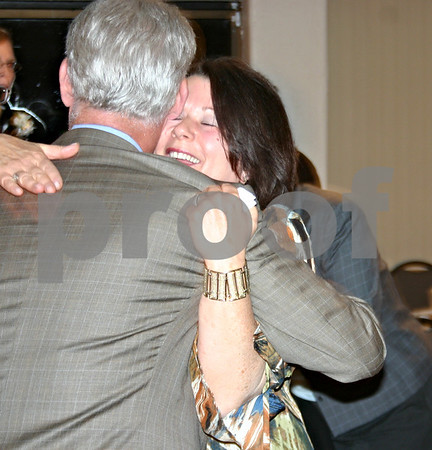 Jeff Engelhardt – jengelhardt@shawmedia.com <br />  Jane Levinsky, owner of Studio One Salon and Day Spa, hugs Craig Mathey after receiving the Athena Award Tuesday at Hopkins Park in DeKalb. Mathey nominated Levinsky for the award, which is given every year to a local woman who demonstrates excellence in their profession, assists women in realizing leadership potential and is active in the community.