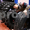 Kyle Bursaw – kbursaw@daily-chronicle.com<br /> <br /> Matt Knebel cleans off tires that will be on display at the Moore Tires booth at the farm show in the Convocation center.