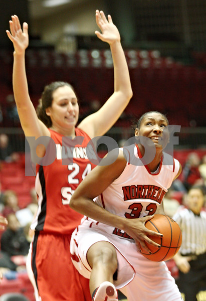 Rob Winner – rwinner@daily-chronicle.com<br /> <br /> Northern Illinois forward Shaakira Haywood controls a rebound under the Huskies' basket during the first half in DeKalb, Ill. on Monday, Jan. 3, 2011.