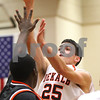 Kyle Bursaw – kbursaw@shawmedia.com<br /> <br /> DeKalb guard Kyle Berg goes up for a shot in the first half of the game against Winnebago in the Chuck Dayton Holiday Tournament in DeKalb, Ill. on Thursday, Dec. 22, 2011. DeKalb defeated Winnebago 46-36.