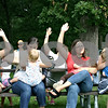 "By Nicole Weskerna - nweskerna@daily-chronicle.com<br /> <br /> Women participating in Saturday's ""big latch"" at Hopkins Park in DeKalb raise their hands to be counted. Eight women participated in the breastfeeding event to kick off World Breastfeeding Week, and each breastfed their children for one minute in hopes of helping break the record for the largest number of women breastfeeding simultaneously."