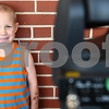 Kyle Bursaw – kbursaw@daily-chronicle.com<br /> <br /> Jack Ager, 4, smiles for a camera taking his picture for identification materials, made for him inside Jewel in DeKalb, Ill. on Friday, July 15, 2011.