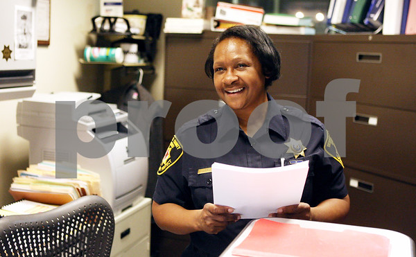 Rob Winner – rwinner@daily-chronicle.com<br /> <br /> Jenny Willis, an administrative assistant of the DeKalb County Sheriff's Office, talks with Sheriff Roger Scott (not pictured) on Monday afternoon in Sycamore.