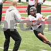 Kyle Bursaw – kbursaw@daily-chronicle.com<br /> <br /> Leighton Settle runs around offensive coordinator Matt Canada during practice at Huskie Stadium on Saturday, April 9, 2011.