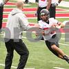 Kyle Bursaw – kbursaw@daily-chronicle.com<br /> <br /> Leighton Settle runs around offensive coordinator Matt Canada during practice at Huskie Stadium on Saturday, April 9, 2011.