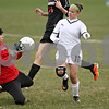 Rob Winner – rwinner@daily-chronicle.com<br /> <br /> Freeport goalkeeper Rebecca Ursin stops a shot by Sycamore's Michelle Doan during the first half on Monday, April 25, 2011, in Sycamore, Ill. Sycamore defeated Freeport, 4-3.