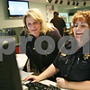 Rob Winner – rwinner@daily-chronicle.com<br /> <br /> Communications deputies Karen Grum (left) and Mary Ann Criscione compile information for detectives at the Communications Division of the DeKalb County Sheriff's Office in Sycamore on Monday afternoon.