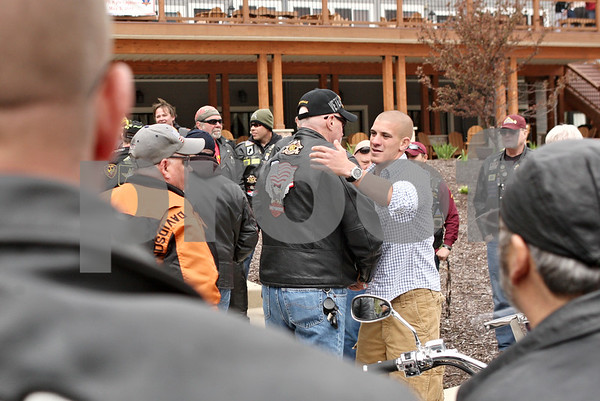 Rob Winner – rwinner@daily-chronicle.com<br /> <br /> United States Marine Corps. Cpl. Kyle LeJeune (right) is hugged by supporters after returning home from Afghanistan during a gathering at the Timber Creek Inn and Suites in Sandwich on Tuesday afternoon.