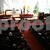 Jeff Engelhardt - jengelhardt@shawmedia.com<br /> Pastor Gary Erickson leads a Christmas Day service Sunday at Bethlehem Evangelical Lutheran Church. Erickson urged congregants to take joy in being children of God this holiday season.