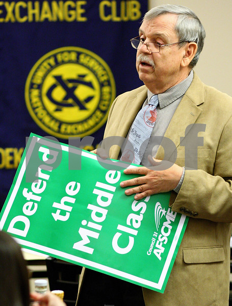 Kyle Bursaw – kbursaw@shawmedia.com<br /> <br /> Earl Shumaker, president of AFSCME Dekalb County Subchapter 70, shows his sign from his trip to Springfield on Wednesday to fellow chapter members before their meeting at the Lincoln Inn in DeKalb, Ill. on Thursday, Oct. 27, 2011.