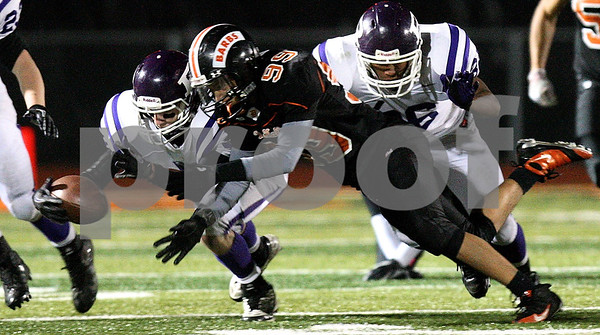 Kyle Bursaw – kbursaw@shawmedia.com<br /> <br /> DeKalb's Mike Lozano and Rochelle's Derek White (left) dive for a loose ball fumbled by another Rochelle player on a kickoff return near the end of the first half at DeKalb High School on Friday, Oct. 21, 2011. The ball eventually rolled out of bounds and Rochelle retained possession.