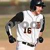 Rob Winner – rwinner@daily-chronicle.com<br /> <br /> DeKalb's Jake Jouris rounds third base after a solo home run in the fifth inning on Wednesday, March 30, 2011 in DeKalb, Ill. Huntley defeated DeKalb, 11-8.