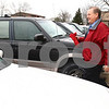 Kyle Bursaw – kbursaw@daily-chronicle.com<br /> <br /> John Horn of the DeKalb Rotary returns to his car after making a delivery for Meals on Wheels in DeKalb, Ill. on Friday, April 15, 2011.