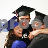 Rob Winner – rwinner@daily-chronicle.com<br /> <br /> Bri Varacalli (from left to right), Cody Jennings and Willis Pope hug before the start of Genoa-Kingston's commencement ceremony on Wednesday night in Genoa.
