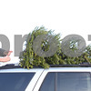 Kyle Bursaw – kbursaw@shawmedia.com<br /> <br /> John Giuliano, of Sycamore, secures a tree on the roof of his vehicle at Camelot Christmas Tree Farm on Tuesday, Dec. 6, 2011.