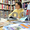 Rob Winner – rwinner@daily-chronicle.com<br /> <br /> Dorothy Laing glances at a quilting book while at the Genoa Public Library during the first day of the Genoa Quilt and Needle Arts Walk on Monday afternoon.