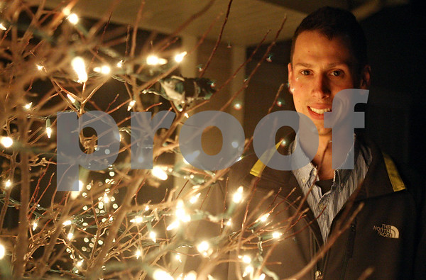 Rob Winner – rwinner@shawmedia.com<br /> <br /> DeKalb resident Nick Andreas has decorated his home with about 60,000 lights that are set to holiday tunes that can be heard from inside your car.<br /> <br /> DeKalb, Ill.<br /> Tuesday, Dec. 6, 2011