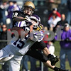 Rob Winner – rwinner@shawmedia.com<br /> <br /> Rochelle's Nick Moore (15) breaks up a pass intended for Sycamore's Riley Hurley (22) in the end zone during the second quarter of a Class 5A playoff game in Sycamore, Ill., on Saturday, Nov. 5, 2011. Rochelle defeated Sycamore, 21-16.