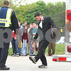 Kyle Bursaw – kbursaw@daily-chronicle.com<br /> <br /> During a simulation for Sycamore high school students to show the devastation of drinking and driving, Sycamore student Jakob Hughes pretends to be intoxicated while performing a sobriety test for an officer on Wednesday, May 18, 2011.