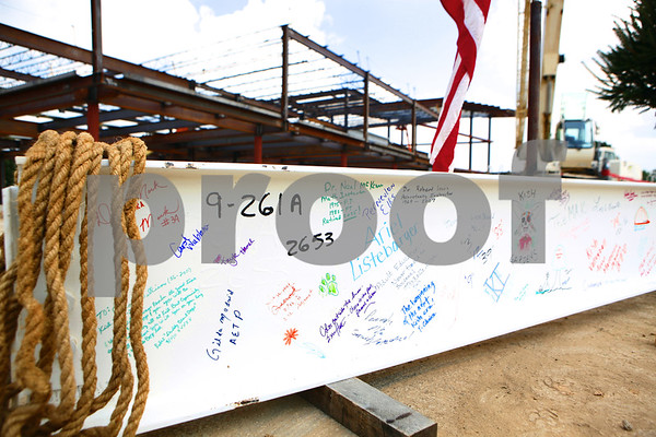 Kyle Bursaw – kbursaw@shawmedia.com<br /> <br /> The final beam in the skeleton of the new student services building at Kishwaukee College waits to be raised into place before a topping off party on Friday, Aug. 19, 2011. The beam was signed by Kishwaukee College students and staff.