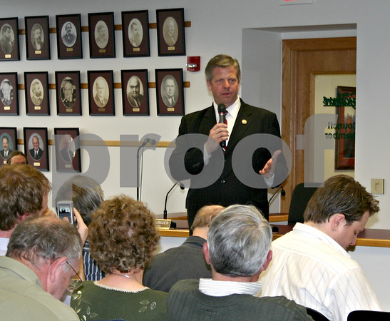 Congressman Randy Hultgren, R-Winfield, fields questions during a town hall meeting in Sycamore Tuesday evening.<br /> <br /> By Nicole Weskerna - nweskerna@daily-chronicle.com