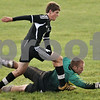 Rob Winner – rwinner@shawmedia.com<br /> <br /> Sycamore goalkeeper Ethan Horlock (right) tries to handle a ball, however Kaneland's Kushstrim Ismaili (4) would eventually score on the play during the first half in Sycamore, Ill., on Tuesday, Sept. 27, 2011. Kaneland defeated Sycamore, 2-0.