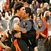 Rob Winner – rwinner@daily-chronicle.com<br /> <br /> DeKalb's Brian Sisler reacts after hitting a three-pointer as time expires in the first half in Sycamore, Ill. on Friday, Feb. 25, 2011. DeKalb defeated Sycamore, 56-42.