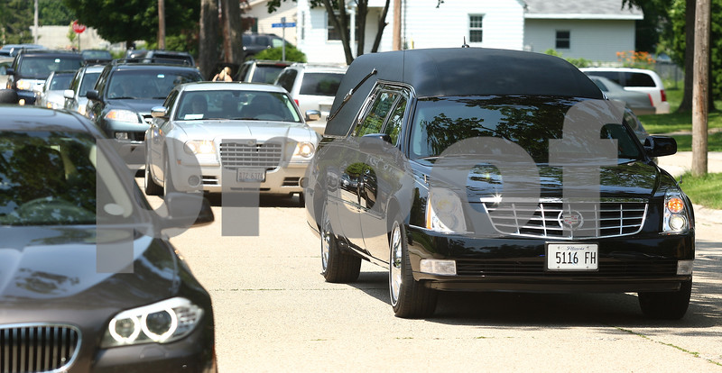 Kyle Bursaw – kbursaw@daily-chronicle.com<br /> <br /> A hearse takes the remains of Jordan Gallagher from The Church of St. Mary to St. Mary Cemetery in DeKalb with a line of cars following it on Thursday, June 30, 2011.