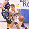 Kyle Bursaw – kbursaw@daily-chronicle.com<br /> <br /> Hinckley-Big Rock's Bernie Conley tries to get around Newark's John Avery in the first quarter in Hinckley, Ill. on Friday, Feb. 11, 2011.