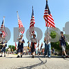 Kyle Bursaw – kbursaw@daily-chronicle.com<br /> <br /> Sycamore Cub Scouts march with American flags Sycamore's Memorial Day Parade.