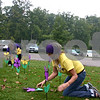 "Kelly Schultz, special events manager for the Alzheimer's Association's Greater Illinois Chapter, and volunteers stick flower pinwheels in the ground Sunday outside the Hopkins Park shelter during DeKalb's first-ever Walk to End Alzheimer's. The flowers, ""planted"" to create a Promise Garden, represented those involved with the walk who have Alzheimer's, those who care for someone with the disease or those who have lost someone to Alzheimer's. <br /> <br /> Caitlin Mullen - cmullen@shawmedia.com"