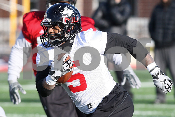 Kyle Bursaw – kbursaw@daily-chronicle.com<br /> <br /> Running back Jamal Womble moves upfield during practice at Huskie Stadium on Thursday, March 24, 2011.