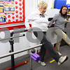 Kyle Bursaw – kbursaw@shawmedia.com<br /> <br /> Ginnie Cook does leg lifts with Kim Henmueller, a Northern Illinois student majoring in athletic training, as the two work through various exercises in the fitness center at Oak Crest on Friday, Nov. 18, 2011.