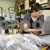 Rob Winner – rwinner@shawmedia.com<br /> <br /> Freshman Lindsey Komes, a Research Rookie, records her findings as she catalogs artifacts that were unearthed from an archaeological dig in New Mexico on Thursday afternoon at Northern Illinois University. Komes has teamed up with professor Winifred Creamer, a faculty mentor, to learn what research looks in her field of study.