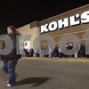 Kyle Bursaw – kbursaw@shawmedia.com<br /> <br /> A woman crosses the street in front of Kohl's where the line stretches past the neighboring storefront around 11:45 p.m. on Thursday, Nov. 24, 2011.