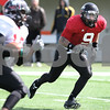 Kyle Bursaw – kbursaw@daily-chronicle.com<br /> <br /> Devon Butler (9) heads for receiver Willie Clark (left) during practice at Huskie Stadium on Saturday, March 26, 2011.