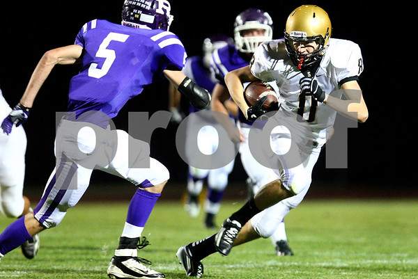 Kyle Bursaw – kbursaw@shawmedia.com<br /> <br /> Sycamore wide receiver Ben Niemann finds some room after the catch while being pursued by Rochelle's defensive back Derek White (5) in the first quarter of their game in Rochelle, Ill. on Friday, Oct. 7, 2011.