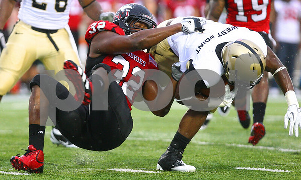 Kyle Bursaw – kbursaw@shawmedia.com<br /> <br /> Northern Illinois' Cameron Bell (32) brings down Army's Raymond Maples (1) during a kick return in the first quarter at Huskie Stadium in DeKalb, Ill. on Saturday, Sept. 3, 2011.