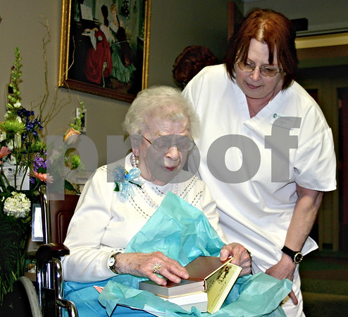 Hazel Swanberg opens a birthday gift from Diane Adamski, a nurse at the Oak Crest Retirement Center in DeKalb. Swanberg celebrated her 108th birthday Thursday.<br /> <br /> By NICOLE WESKERNA nweskerna@daily-chronicle.com