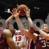 Rob Winner – rwinner@shawmedia.com<br /> <br /> While trying to control a rebound under the Huskies' basket, Northern Illinois' Kevin Gray (13) is fouled by Southern Illinois' Treg Setty (35) during the second half in DeKalb, Ill., on Saturday, Dec. 17, 2011. SIU defeated NIU, 62-49.