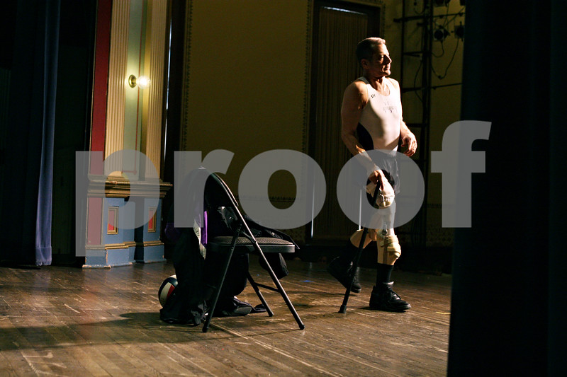 Rob Winner – rwinner@daily-chronicle.com<br /> <br /> Lloyd Bachrach walks on stage after removing his jogging pants to reveal his prosthetic legs during a presentation for local school children at the Sandwich Opera House in Sandwich on Thursday afternoon.
