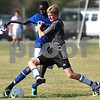 Kyle Bursaw – kbursaw@daily-chronicle.com<br /> <br /> DeKalb's Nick Sablich battles a Burlington Central player for possession in the first half at Huntley Middle School on Friday, July 22, 2011.