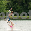 Rob Winner – rwinner@daily-chronicle.com<br /> <br /> Genoa resident Katie Tuma, 14, tosses Jacob Nieder, 7, of Ottawa, while cooling off at the Sycamore RV Resort beach on Monday afternoon.
