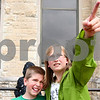 Kyle Bursaw – kbursaw@daily-chronicle.com<br /> <br /> After releasing their own small weather balloons, Faith and Lucas Hendley watch their balloons fly away outside Davis Hall at NIU during the meteorology and geography kid's day on Saturday, May 7, 2011.