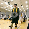 Rob Winner – rwinner@daily-chronicle.com<br /> <br /> Jeremiah Duvick walks to the front of the line before his name is called as graduating seniors at Sandwich Community High School receive their diplomas on Sunday in Sandwich.