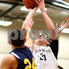 Kyle Bursaw – kbursaw@shawmedia.com<br /> <br /> Sycamore forward Tom Paulson takes a shot over Sterling's Alejandro Rivera during first quarter of their match in the Chuck Dayton Holiday Tournament at DeKalb High School on Friday, Dec. 23, 2011. Sterling defeated Sycamore 61-41.